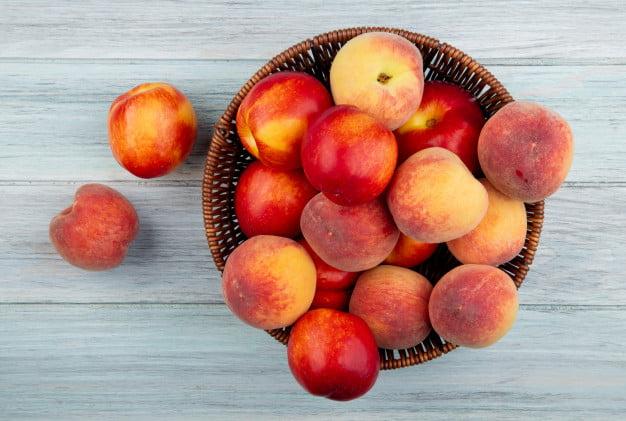 risolatte alla pesca un dessert top view fresh ripe nectarines peaches wicker basket white background 141793 6475