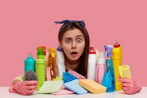 detersivi per i piatti per terrific young woman with unexpected gaze wears headband has many detergents table shocked wth dirty room wears protective gloves 273609 24003